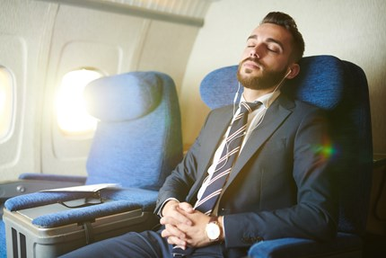 Relaxing on a flight knowing accommodation is secured.